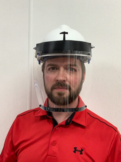 Man wearing hard hat with face shield